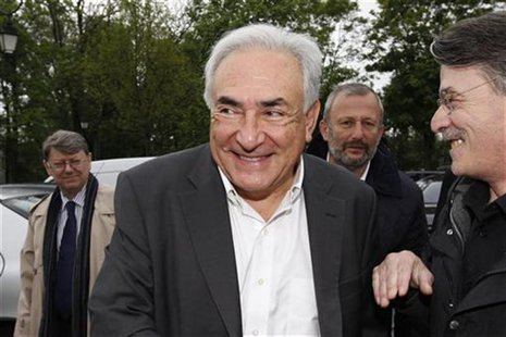 Former IMF head Dominique Strauss-Kahn (C) and Francois Pupponi (2ndR), Deputy Mayor of Sarcelles arrive at a polling station in the second