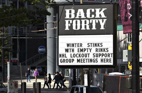 A pub near the home arena of the NHL Vancouver Canucks posts a sign in regarding the current league and players dispute in Vancouver, Britis