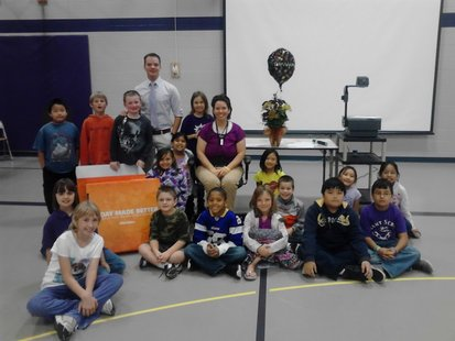 Christine Smith and her 3rd grade class receive $1,500 in office supplies from OfficeMax, October 2 2012
