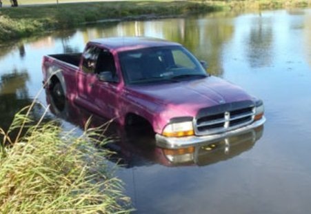 Pick-up truck driven into lake