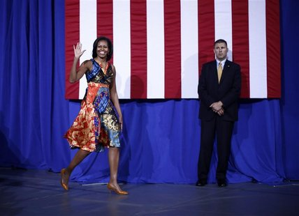 U.S. first lady Michelle Obama arrives to speak at an election campaign rally to re-elect her husband Barack Obama at the University of Mary