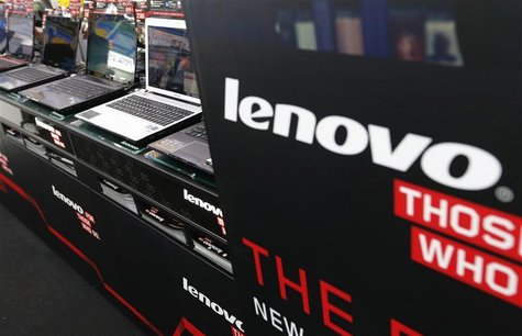 Lenovo's laptop PCs are displayed at an electronic shop in Tokyo September 5, 2012. REUTERS/Kim Kyung-Hoon (JAPAN - Tags: BUSINESS)