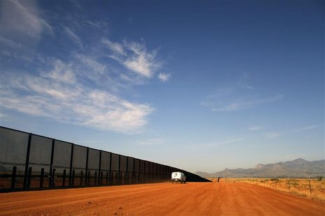 A U.S. Border vehicle drives along the U.S. and Mexico border fence in Naco, Arizona, in this September 7, 2011 file photo. One U.S. Border