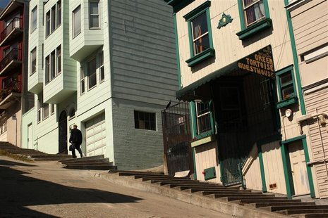 A man climbs a set of stairs built into the sidewalk in the North Beach neighborhood in San Francisco, California May 27, 2012. REUTERS/Robe