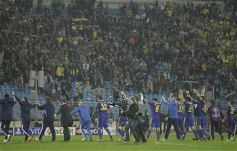 BATE Borisov's players, staff and supporters celebrate victory over Bayern Munich after their Champion's League Group F soccer match in Mins