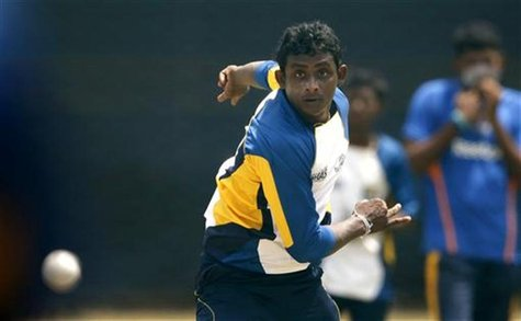 Sri Lanka's Ajantha Mendis bowls during a practice session ahead of their first Super Eight match against New Zealand in Pallekele September