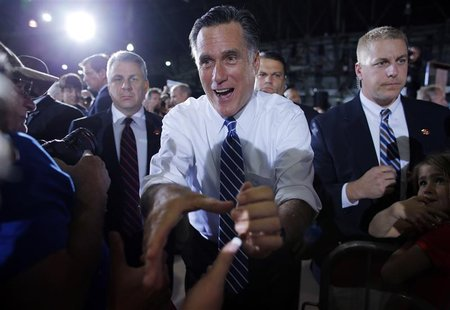 U.S. Republican presidential candidate and former Massachusetts Governor Mitt Romney greets audience members at a campaign rally in Denver,