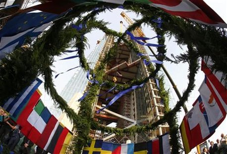 The topping out wreath carrying the flags of the 27 EU member states is lifted up during the topping out ceremony at the construction site o
