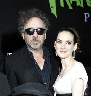 "Director and producer Tim Burton poses with cast member Winona Ryder at the premiere of ""Frankenweenie"" at El Capitan theatre in Hollywood,"