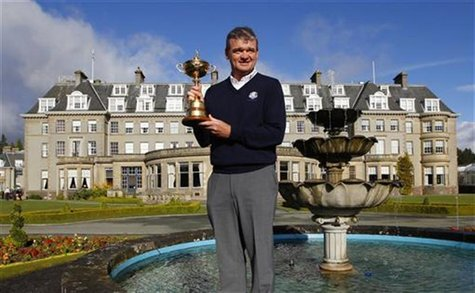 Europe Ryder Cup team golfer Paul Lawrie poses with the Ryder Cup during a photocall in front of the Gleneagles Hotel, the venue for the 201
