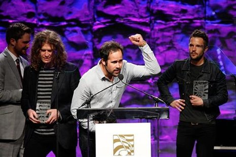 Drummer Ronnie Vannucci Jr. of the rock band The Killers gestures as the band receives the Vanguard Award at the 27th annual ASCAP Pop Music