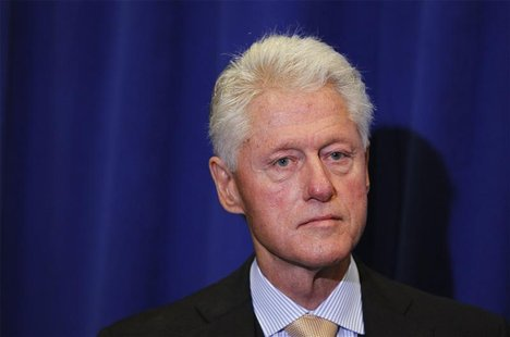 Former U.S. President Bill Clinton waits to speak during an announcement related to the U.N. Commission on Life-Saving Commodities and Contr