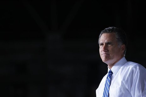 Republican presidential candidate and former Massachusetts Governor Mitt Romney pauses while speaking at a campaign rally in Denver, Colorad