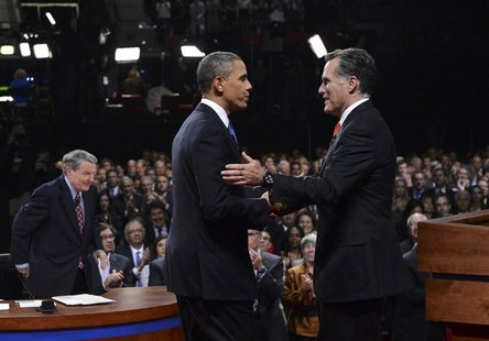 Republican presidential nominee Mitt Romney shakes hands with President Barack Obama as mediator Jim Lahrer gets up at the end of the first