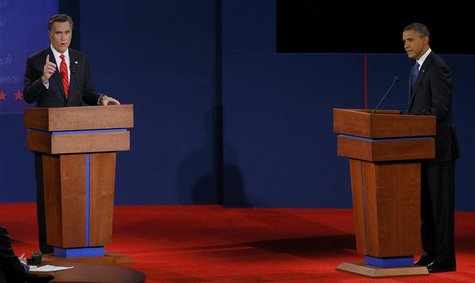 President Barack Obama (R) listens as Republican presidential nominee Mitt Romney speaks during the first presidential debate in Denver Octo
