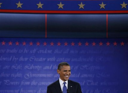 President Barack Obama smiles during the first presidential debate with Republican presidential nominee Mitt Romney (not pictured) in Denver