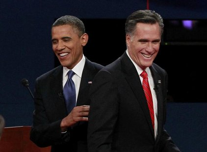 President Barack Obama (L) and Republican presidential nominee Mitt Romney share a laugh at the end of the first presidential debate in Denv