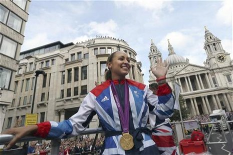 British Olympic heptathlon gold medalist Jessica Ennis waves to the crowd during the London 2012 Victory Parade for Team GB and Paralympic G