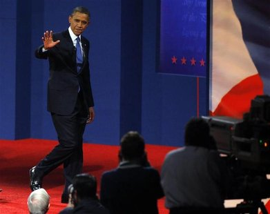 U.S. President Barack Obama walks offstage following the first 2012 U.S. presidential debate with Republican presidential nominee and former