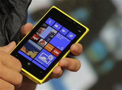 A Nokia executive shows the new Lumia 920 phone with Microsoft's Windows 8 operating system at a launch event in New York, September 5, 2012