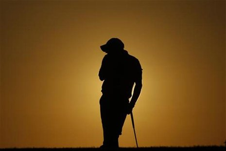Paul McGinley of Ireland rests on the 18th hole during the first round of the Portugal Master golf tournament in Vilamoura October 14, 2010.