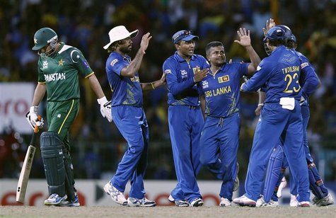Sri Lanka's Rangana Herath (2nd R) celebrates with his teammates after he took the wicket of Pakistan's Shahid Afridi (L) during their Twent