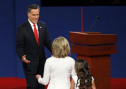 Republican presidential nominee and former Massachusetts Governor Mitt Romney (back) greets his wife Ann at the conclusion of the first U.S.