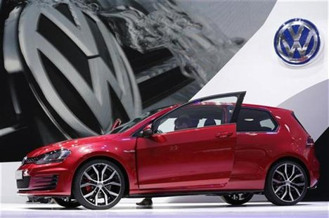 A new model of the Volkswagen Golf GTI is displayed on media day at the Paris Mondial de l'Automobile September 27, 2012. The Paris auto sho
