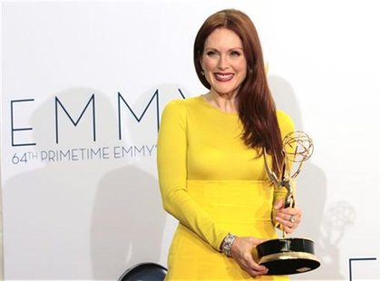 "Actress Julianne Moore holds the Emmy award for outstanding lead actress in a miniseries or movie for ""Game Change"" at the 64th Primetime Em"