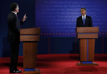 Republican presidential nominee Mitt Romney answers a question as U.S. President Barack Obama listens during the first presidential debate i