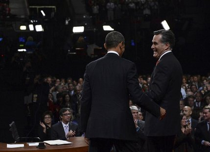 Republican presidential nominee Mitt Romney greets President Barack Obama at the end of the first 2012 U.S. presidential debate in Denver Oc
