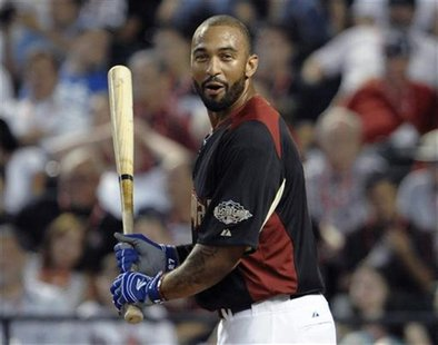 The National League's Matt Kemp, of the Los Angeles Dodgers, reacts in the first round of Major League Baseball's Home Run Derby at the All-