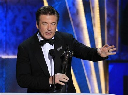 "Actor Alec Baldwin accepts the award for outstanding performance by a male actor in a comedy series for ""30 Rock"" at the 18th annual Screen"