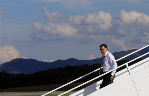 Republican presidential nominee Mitt Romney gets off his campaign plane at the airport in Weyers Cave, Virginia October 4, 2012. REUTERS/Bri