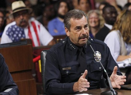 Los Angeles Police Chief Charlie Beck addresses the Los Angeles City Council during a public discussion regarding a proposed ban on medical