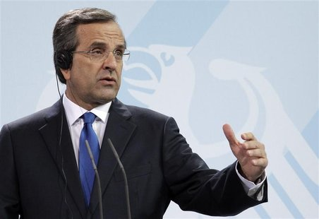 Greek Prime Minister Antonis Samaras addresses a news conference after talks with German Chancellor Angela Merkel in Berlin, August 24, 2012
