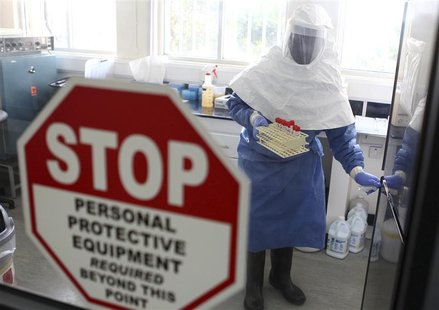 A doctor works in a laboratory on collected samples of the Ebola virus at the Centre for Disease Control in Entebbe, about 37 km (23 miles)