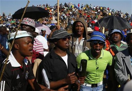 Striking miners evicted from company housing at a gold mine occupy a hill near the mine in Carltonville, west of Johannesburg October 2, 201