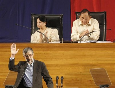 Philippine President Gloria Macapagal Arroyo (upper L) and Jose De Venecia, a speaker of the House of the Representatives, gesture while Gho
