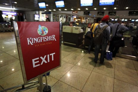 Kingfisher Airlines customers wait at a check-in queue at Mumbai's domestic airport in this March 20, 2012 file photograph. REUTERS/Vivek Pr