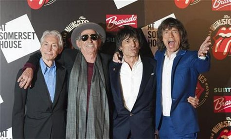 "The Rolling Stones (L-R) Charlie Watts, Keith Richards, Ronnie Wood and Mick Jagger pose as they arrive for the opening of the exhibition ""R"