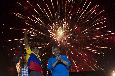 Venezuela's opposition presidential candidate Henrique Capriles (2nd L) greets supporters during a campaign rally in Barquisimeto, in the st