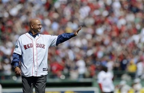 Former Boston Red Sox manager Terry Francona gestures to the crowd as he takes the field during the pre-game ceremony as Fenway Park commemo