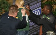 AJ Hawk and James Jones signing a jersey photo