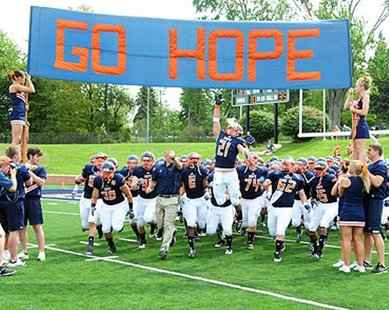 Hope College's football team enters the field for the first game of the 2012 season versus North Park on Sept. 1, 2012. (photo courtesy Hope College)