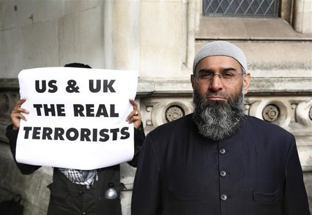 Demonstrator Anjem Choudary, protests in support of Islamist cleric Abu Hamza al-Masri, who is appealing against his extradition to the U.S.