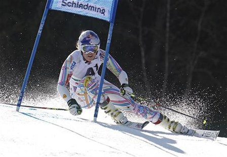 Lindsey Vonn of the U.S. clears a gate during the women's alpine skiing giant slalom race at the World Cup finals in Schladming March 18, 20