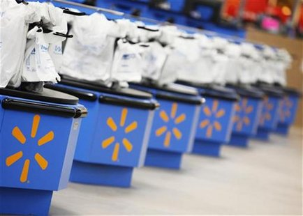 The Wal-Mart logo is pictured on cash registers. REUTERS Photo/John Gress
