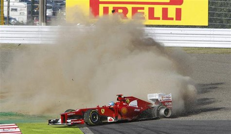Ferrari Formula One driver Fernando Alonso of Spain loses control of his car in the first corner of the Japanese F1 Grand Prix at the Suzuka