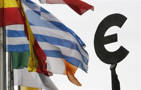 Greek and others European national flags flutter near an euro symbol outside the EU Parliament in Brussels August 30, 2011. REUTERS/Francois
